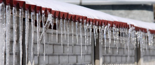 Icicles on the roof along the fence